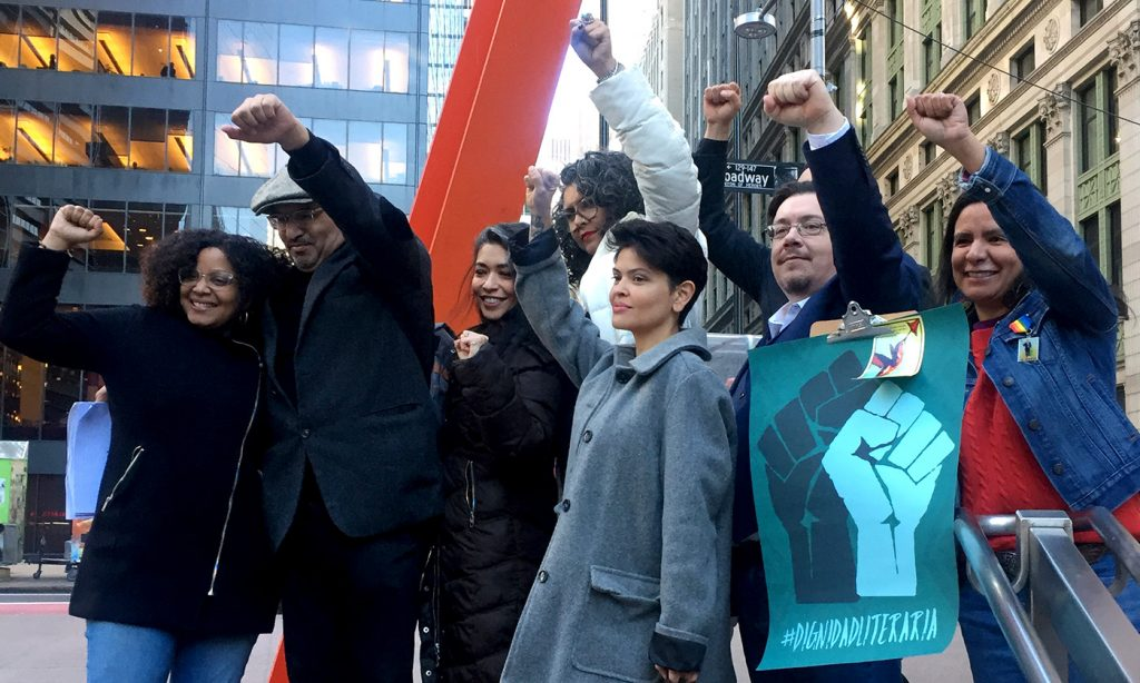 "Hispanic writers raise theirs fists after meeting with the CEO of MacMillan USA and executives of its division Flatiron to protest the publication of the novel ""American Dirt"" in New York City on February 2, 2020. - The writers have created a new movement called Dignidad Literaria to push for more diversity in the publishing industry, both in terms of staff and number of books published by Hispanic authors. (Photo by Laura BONILLA CAL / AFP) (Photo by LAURA BONILLA CAL/AFP via Getty Images)"
